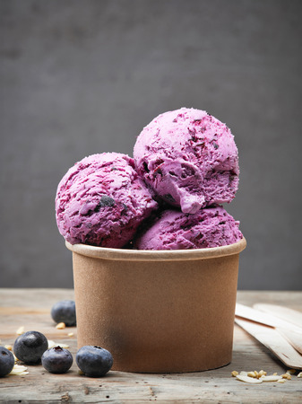 Blueberry and almond ice cream on wooden table