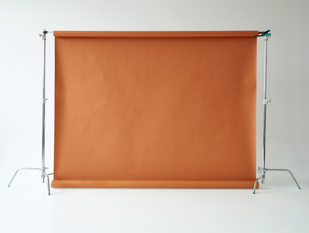 Brown paper backdrop in day light photo studio