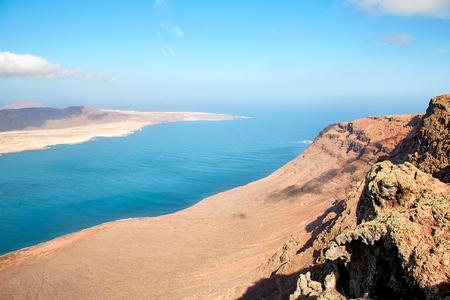 view of the volcanic coastline and Isla Graciosa from Mirador del Rio viewpoint, Lanzarote, Spain