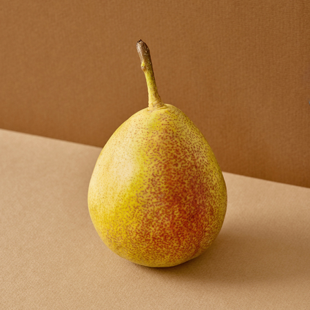 fresh pear on colored brown paper background Stock fotó