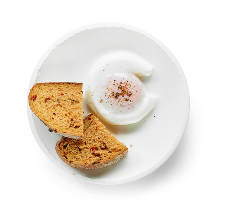 poached egg and bread on white plate isolated on white background, top view Stock fotó