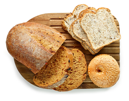 Various kinds of bread on cutting board, top view Stock fotó