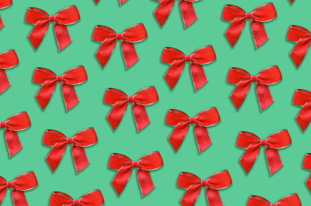 Red decorative bow pattern on green