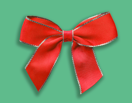 Red decorative bow on green