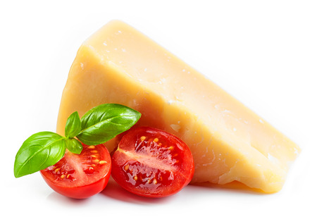 Cheese, basil and tomato isolated on white