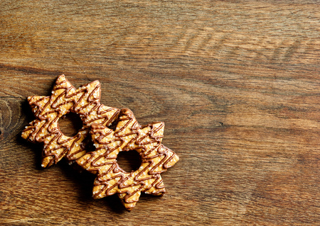 christmas cookies decorated with chocolate and sugar on wood table, top view