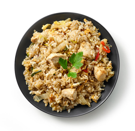 plate of asian food, fried rice with meat and vegetables isolated on white background, top view Stock fotó
