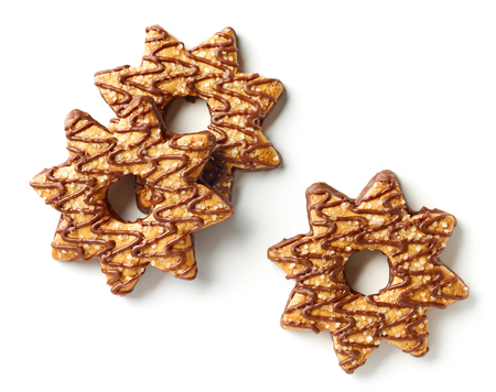 star shaped cookies decorated with chocolate and sugar isolated on white background, top view
