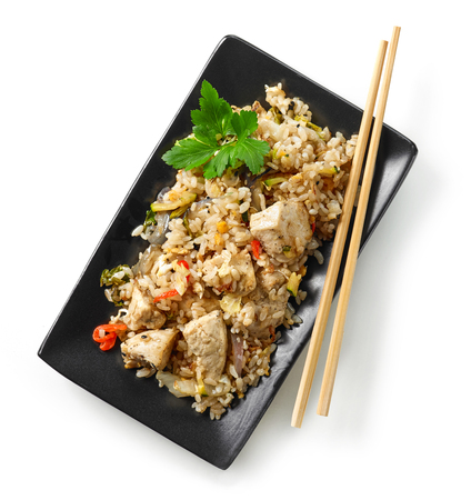 plate of asian food, fried rice with chicken and vegetables isolated on white background, top view Stock fotó