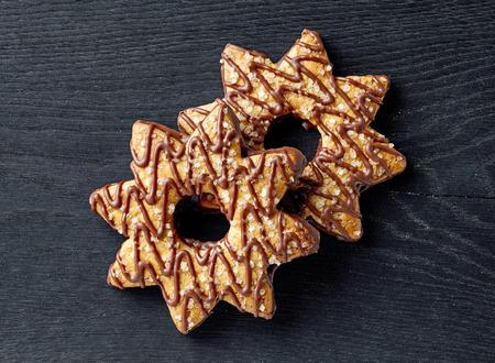 star shaped cookies on black wood board, top view Stock fotó
