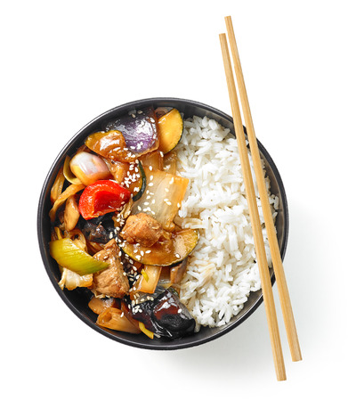 bowl of asian food, boiled rice with meat and vegetables, top view