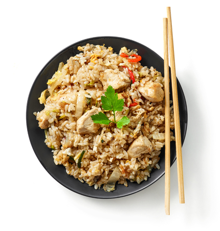 plate of asian food, fried rice with chicken meat, top view
