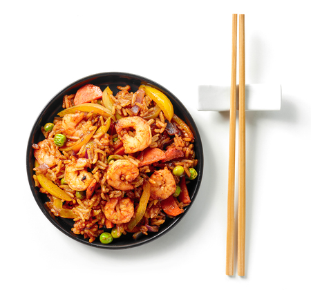 plate of asian food, fried rice with shrimps and vegetables, top view