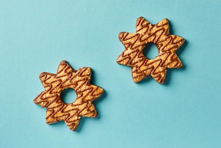 star shape cookies on blue paper background, top view Stock fotó