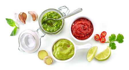 various homemade dip sauces isolated on white background, top view
