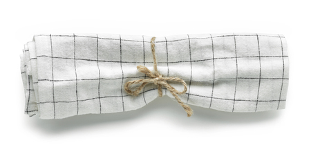 folded linen napkin isolated on white background, top view