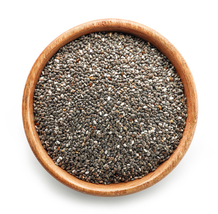 chia seeds in wooden bowl isolated on white background, top view