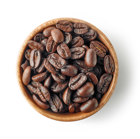 wooden bowl of coffee beans isolated on white background, top view Stock Photo