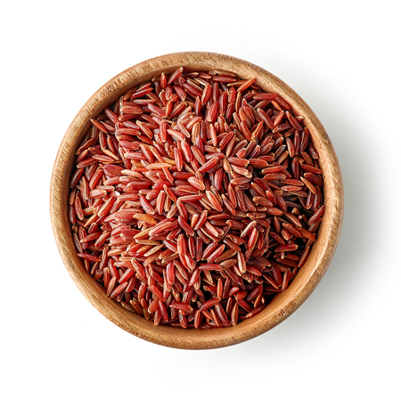 wooden bowl of red rice isolated on white background, top view