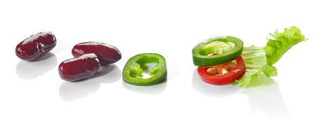 colorful food ingredients red beans, chili and lettuce isolated on white background