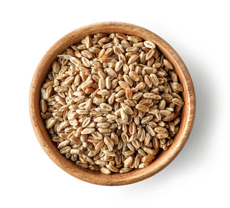 wooden bowl of wheat grains isolated on white background, top view