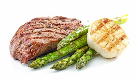 grilled beef fillet steak and vegetables isolated on white background