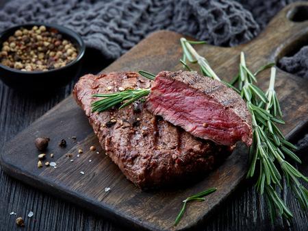 grilled beef fillet steak meat on dark wooden table 写真素材