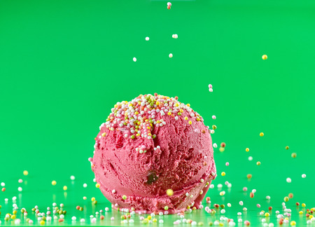 red cherry ice cream on green background