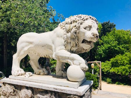 Statuette of lion in Rodini Park - historic park in Rodos, Rhodes island, Greece