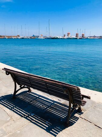 Old wooden bench in Rodos, Greece