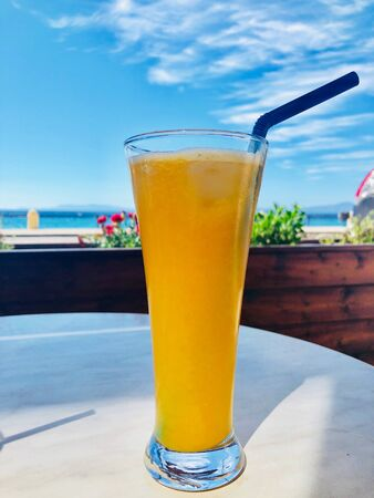 glass of fresh orange juice on restaurant table, Rhodes island, Greece