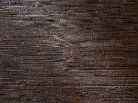 Draufsicht des dunkelbraunen Holzhintergrundes