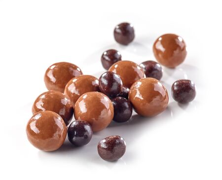 chocolate balls berries covered with chocolate isolated on white background