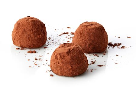 Chocolate truffles covered with cocoa isolated on white Reklamní fotografie
