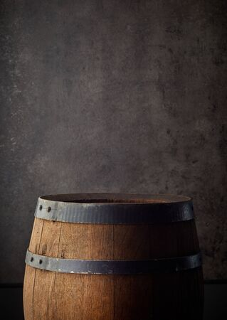old wooden barrel on grey background, copy space Reklamní fotografie