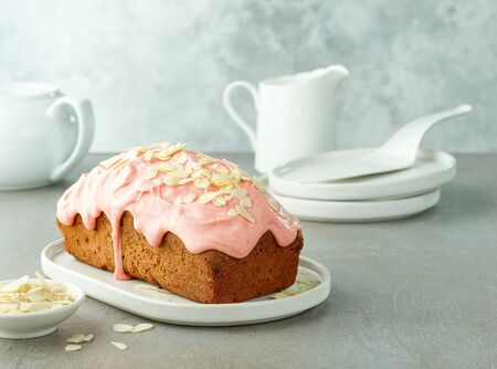 sweet almond bread covered with melted raspberry white chocolate, still life