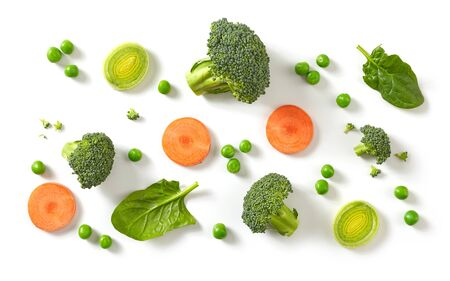composition of fresh broccoli, carrot and green peas isolated on white background, top view Фото со стока