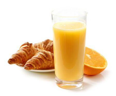 glass of orange juice and croissants isolated on white background