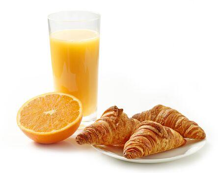 freshly baked croissants and orange juice isolated on white background Zdjęcie Seryjne