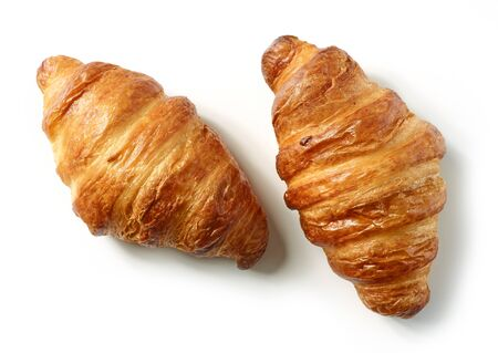 freshly baked croissants isolated on white background, top view