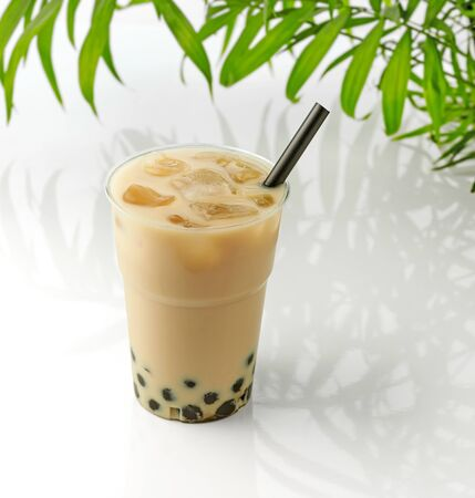 glass of iced bubble tea with milk