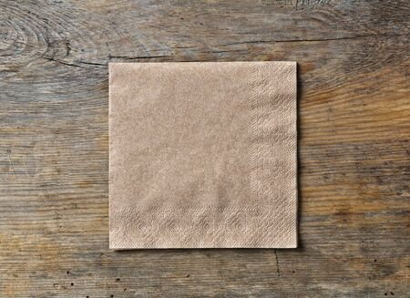 brown paper napkin on wooden kitchen table, top view