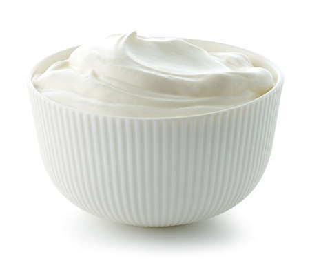 bowl of sour cream or greek yogurt isolated on white background