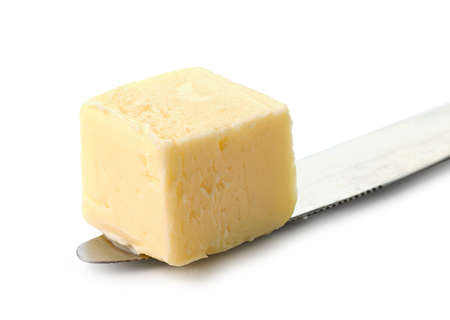 piece of butter on a knife isolated on white background