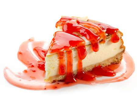 piece of cheesecake with strawberry sauce isolated on white background