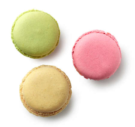 various colorful macaroons isolated on white background, top view