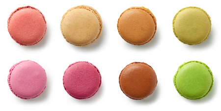 various colorful macaroons isolated on white background, top view Foto de archivo