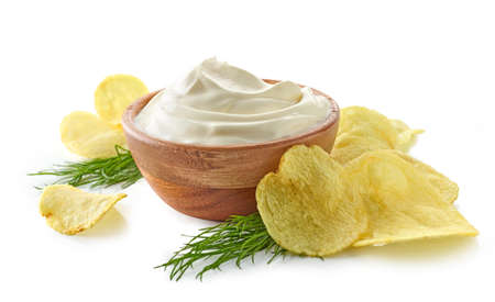 potato chips and bowl of sour cream dip isolated on white background Standard-Bild