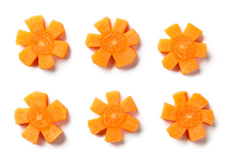 fresh raw carrot flowers isolated on white background, top view 免版税图像