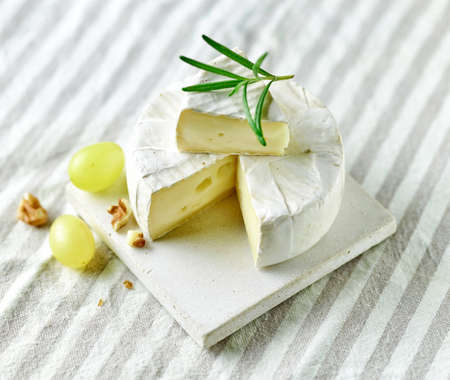fresh brie cheese on kitchen table
